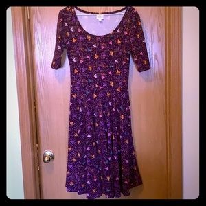 Purple dress with designs.